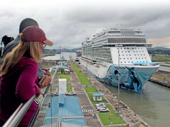 WELCOME MY FRIEND: People look at Norwegian Bliss, the largest cruise ship to transit the expanded Panama Canal through Cocoli locks, as it passes through the Canal on the outskirts of Panama City during the month of May