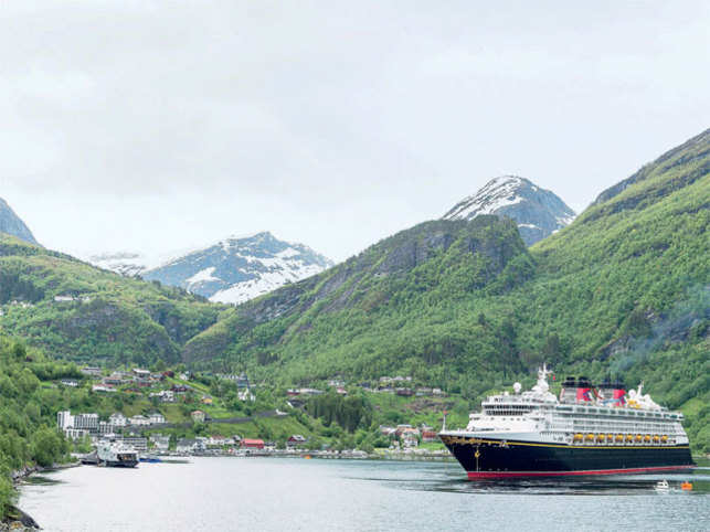 WITNESSING THE MAJESTIC FJORDS: The beautiful sighting of the Fjords is a spectacular moment for many travellers. (In the pic) A cruiseliner arrives in Geiranger, Norway while sailing into the majestic fjord that inspired the fairytale kingdom of Arendelle in the animated hit Frozen