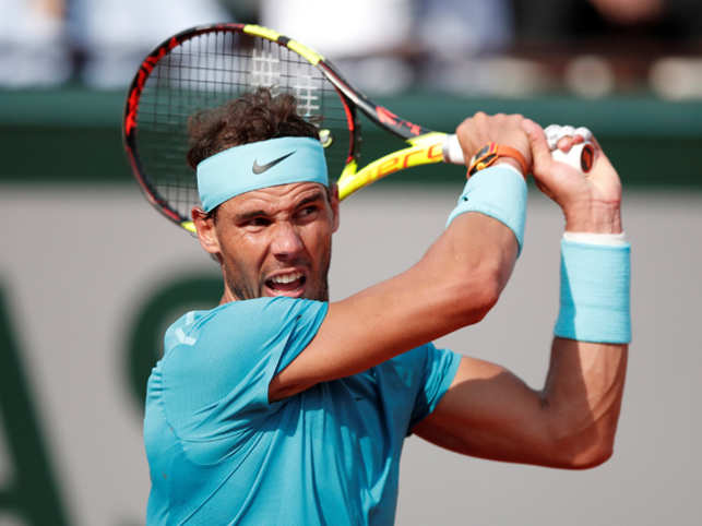 Rafael Nadal shows his old class to see off Milos Raonic ...
