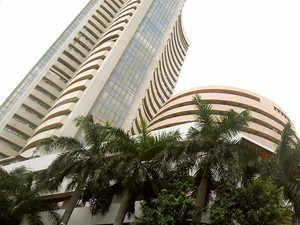 Sensex, Nifty open flat amid renewed trade war concerns