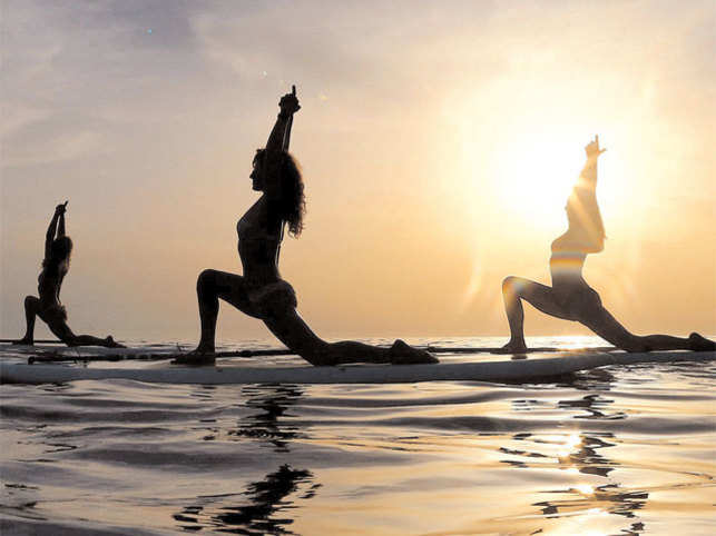 SALUTATIONS TO THE SUN: Spend some time replenishing Vitamin D levels along with some early morning yoga sessions