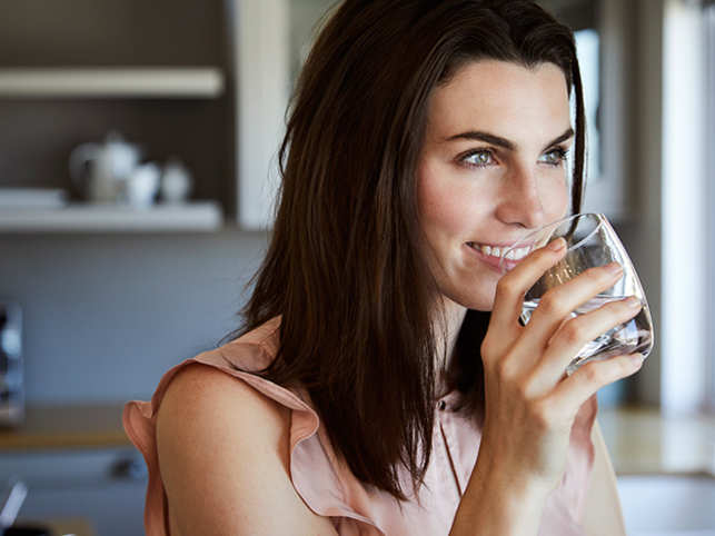 woman-drinking-water-ThinkstockPhotos-841189442