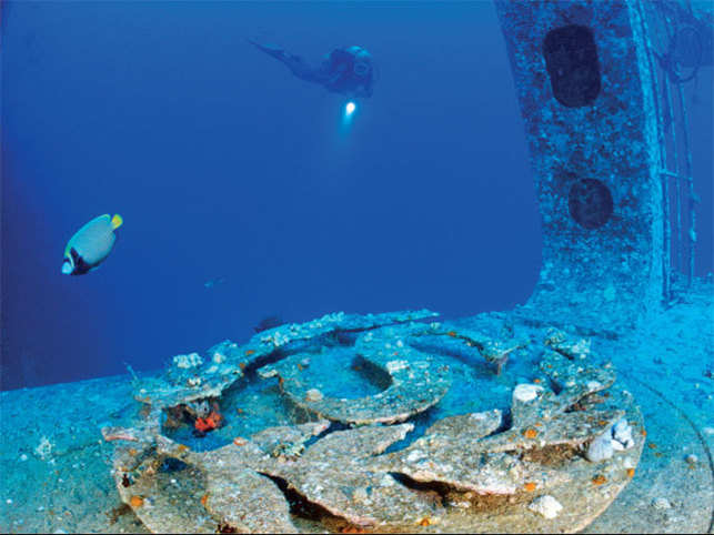 LETTING NATURE TAKE ITS COURSE: A Scuba diver explores the ship wreck of Thistlegorm in Red Sea, Egypt (©GettyImages)