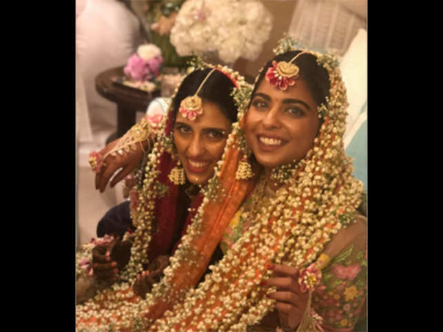 Reliance Industries Chairman Mukesh Ambani and wife Nita threw a mehendi party at Antilia to kickstart the celebrations for their son Akash Ambani's engagement to Shloka Mehta. 	 	In pic: Sisters-in-law, friends, and brides-to-be Isha Ambani and Shloka gave floral jewellery a new definition, going all out with a flower-studded dupatta at the ceremony. 	 	Also Read: Priyanka Chopra attends Akash Ambani & Shloka Mehta's mehendi ceremony, posts loving message 	 	(Image: Instagram/PriyankaChopra)