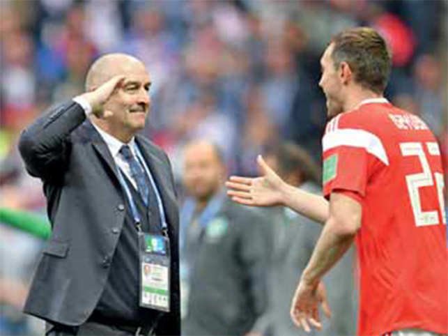 As the World Cup nears its grand finale, a look at the men at the sidelines and their dramatic gesticulation over the tournament, so far.Man Mountain Artem Dzyuba gets a military tribute from his team's head coach Stanislav Cherchesov after he scored the team's third goal against Saudi Arabia.