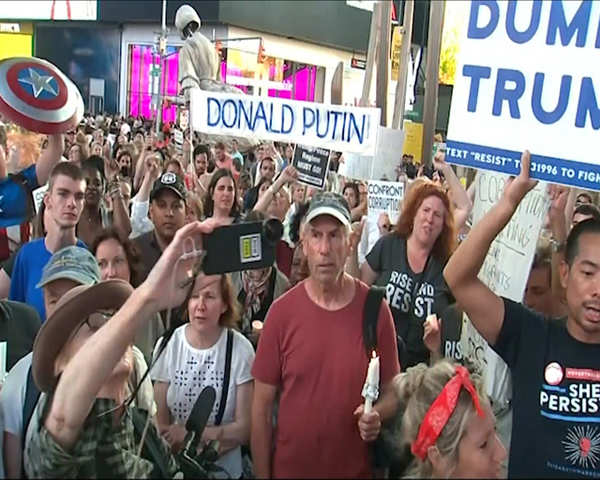 Image result for times square protest july 19th donald putin