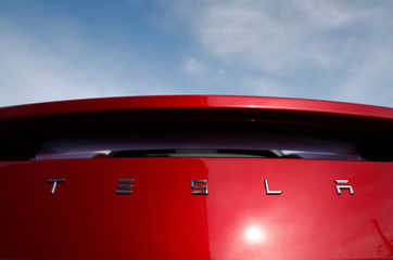 Tesla shares drop on report that it asked suppliers for refunds