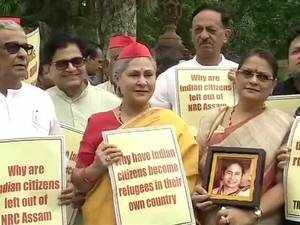 Opposition party MPs protest outside the Parliament over the NRC report