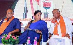Jaipur: Rajasthan Chief Minister Vasundhara Raje and BJP state President Madanl...