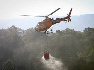 Helicopter collects water during wildfires in Portugal AFP