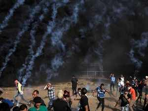 Israeli forces fire tear gas at stone throwing protesters near Gaza border