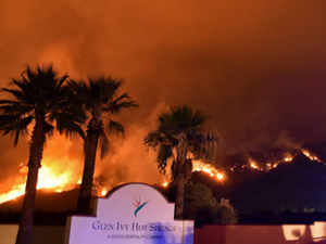The Holy Fire burns near homes outside Glen Ivy Hot Springs in Corona California AFP