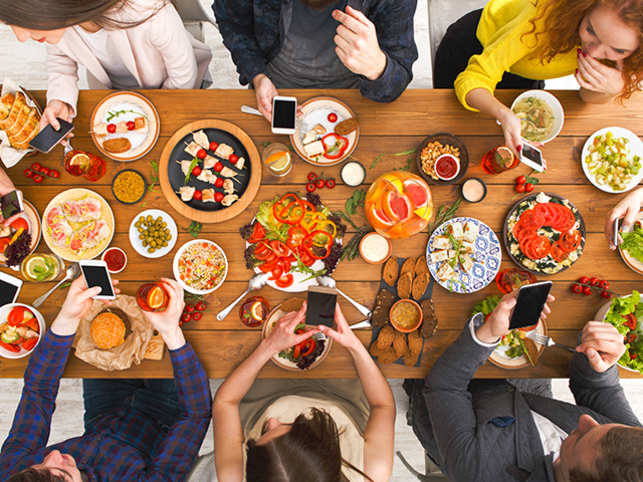 food-eat-work-phone-tech-GettyImages-827951722