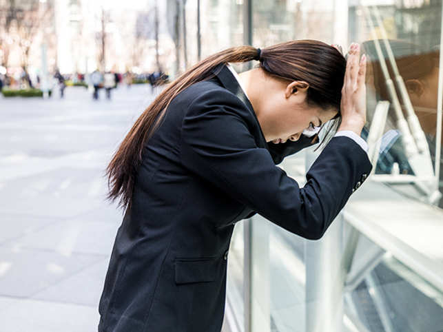 work-tired-sorry-apologise-woman-office-GettyImages-829043318