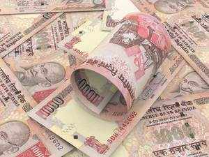 Rupee hits a new low of 71.10 against dollar
