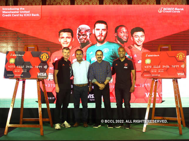 (From left) Manchester United- ICICI Bank cobranded credit cards being unveiled at an exclusive match screening event by Denis Irwin, former Manchester United player, Sudipta Roy, general manager, ICICI Bank, Anup Bagchi, ED, ICICI Bank, and Quinton Fortune, former Manchester United player