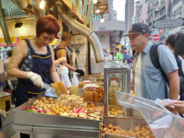 ​A typical busy street food stall​ in Hong Kong.