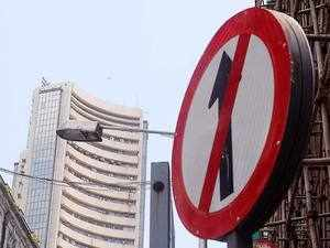Sensex slumps 218 pts on Fed rate hike, F&O expiry; Nifty below 11K-mark