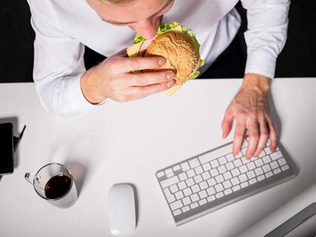 stress-eating-food-work-office-burger-GettyImages-518905244