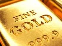 Gold hovers in narrow range as dollar rises on upbeat US data
