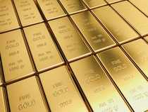 Gold dips as dollar firms after China eases policy