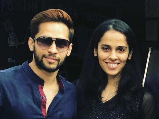 Parupalli Kashyap and Saina Nehwal (R)