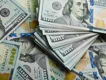 Dollar hovers near two-week lows on falling yields, Wall Street losses