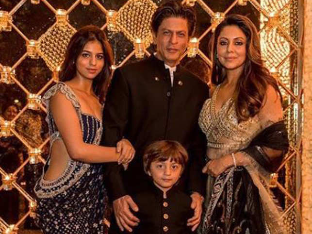 Shah Rukh Khan and wife Gauri, along with daughter Suhana, hosted a stunning Diwali bash on Saturday at their Mumbai residence 'Mannat'.  And as is wont, the crème de la crème of B-town turned up in full strength at the star's Bandra residence. Gold, black and glitter stole the show as the hosts and most guests themed their outfits in similar hues.  From friends like family - Karan Johar, Alia Bhatt, Kajol, Kareena Kapoor Khan - to former co-stars - Juhi Chawla, Malaika Arora, Karisma Kapoor - and designer buddy Manish Malhotra, it was a glitzy affair as their Instagram feeds proved.  (Image: Gauri Khan/Instagram)