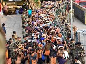 Devotees flock Sabarimala as portals open amid protests, heavy security