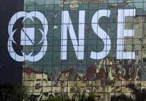 Buildings are reflected on the glass windows of the National Stock Exchange building in Mumbai