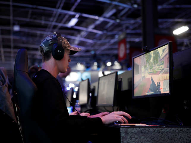 A gamer plays PUBG at the Paris Games Week in France.