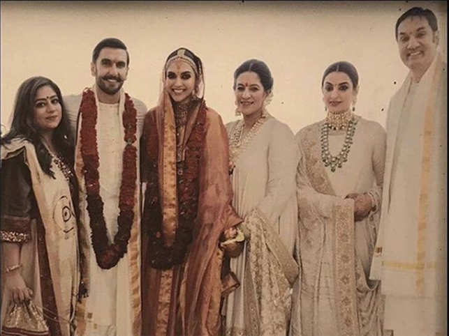 7ccaeac5ee1 Deepika Padukone and Ranveer Singh strike a pose with his family post the  Konkani wedding ceremony. (Image  Instagram Filmfare)