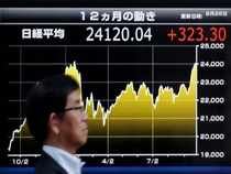Asian shares fall as growth, trade concerns dog China markets