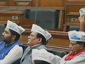 AAP MLAs don party caps inside Delhi Assembly, BJP says its violation of rules