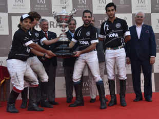 The-winning-team,-Sona-Koyo,-captained-by-Sanjay-Kapur,-lifts-the-prestigious-trophy-for-the-Sir-Pratap-Singh-Polo-Cup