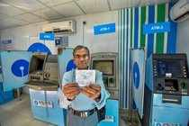 Patna: A man showing out of cash slips near SBI ATMs in Patna on Tuesday. Most o...