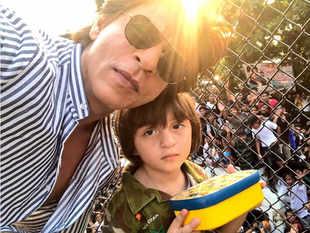 King Khan spreads some Christmas cheer: AbRam, SRK strike iconic pose