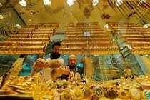 Goldsmiths arrange products in a gold and jewellery store in Istanbul