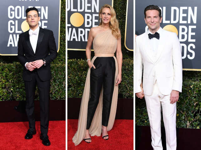 The first entertainment awards gala of 2019, 76th annual Golden Globes awards, was a starry affair full of heartwarming speeches, laughs and a few tears at the Beverly Hilton. Who's who of the industry were spotted at the event in iconic style.Not just the ladies, the men put their best foot forward too. The night was host to the hottest stars of Hollywood at their fashionable best.Here's a look at all the red carpet arrivals of the 76th Golden Globes Awards.(In pic from left: Rami Malek, Julia Roberts, Bradley Cooper)