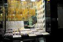 A salesman is seen at his gold shop in Gold Souq in Dubai