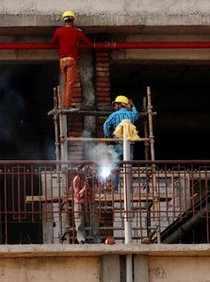 Gurugram: Labourers work at a construction site in Gurugram. Construction worker...