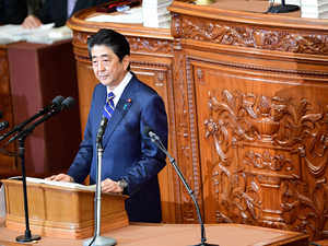 Japan PM vows to step up China ties but bolster defense