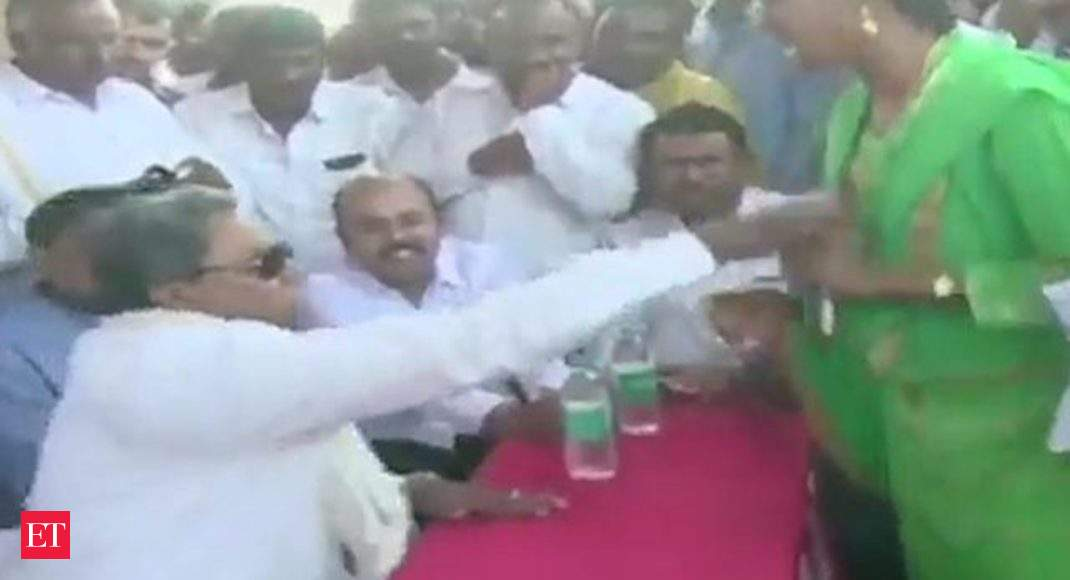 Watch: Congress' Siddaramaiah intimidates a woman at public meeting in  Mysuru