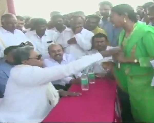 Watch: Congress' Siddaramaiah intimidates a woman at public meeting in  Mysuru