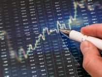 Sensex, Nifty volatile after RBI cuts repo rate, changes stance