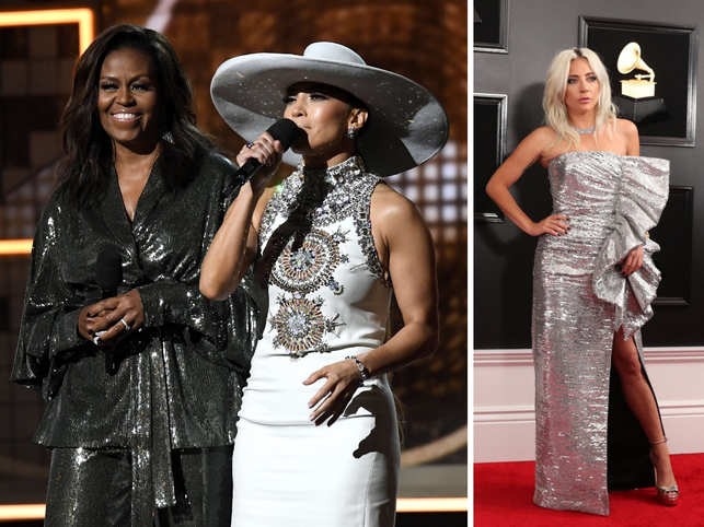 Sparkly, studded and strutting in designer looks, the Grammys parade of often out-there fashion kicked off in a downpour Sunday, but that didn't dampen spirits as the music industry's best showed off their myriad outfits.