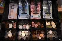A shop cash register is seen with both Sterling and Euro currency in the till at the border town of Pettigo