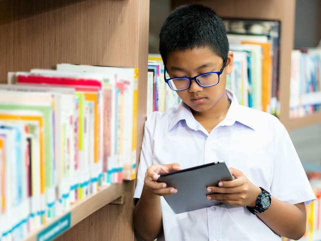 child-boy-library-school-sp