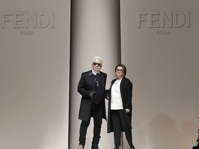 92dd7aa0 26, 2015 file photo, Silvia Venturini Fendi, right, and Karl Lagerfeld  acknowledge the applause of the audience after presenting the Fendi women's  ...