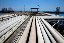 FILE PHOTO: An oil tanker is being loaded at Saudi Aramco's Ras Tanura oil refinery and oil terminal in Saudi Arabia